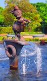 Daisy duck at disneyland hong kong. Bronze statue of daisy duck in the fountain at disneyland, hong kong Royalty Free Stock Photography