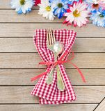 Daisy Flowers in Red White and Blue Colors as a Party Invitation Card Laying on Rustic Board Table with room or space for your wor Royalty Free Stock Image