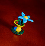 Daisy in a pot. Children's crafts from polymer clay Royalty Free Stock Photo