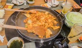 Dak Galbi Korean spicy food on hot pan stock photos