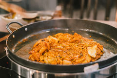 Dak-Galbi, Korean traditional food. Spicy stir-fried chicken, pork, meat, seafood, and vegetable, Served and fried on rounded hot stock photos