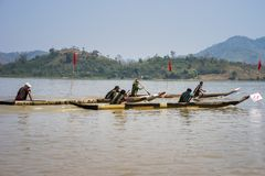 Dak Lak , Vietnam - March 12, 2017 : Traditional dug-out canoe racing festival on the Lak lake in Dak Lak, center highland of Viet. Nam Royalty Free Stock Images