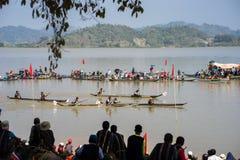 Dak Lak , Vietnam - March 12, 2017 : Traditional dug-out canoe racing festival on the Lak lake in Dak Lak, center highland of Viet. Nam Stock Image