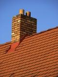 Dak met schoorsteen Stock Foto