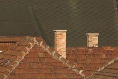 Daken en schoorstenen stock afbeelding