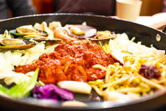 Dakgalbi or Spicy grilled chicken and vegetables recipe. Dak galbi, also romanized dalk galbi, is a popular Korean dish generally made by stir-frying marinated Stock Photos
