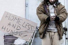 Dakloze en hongerige zwerver royalty-vrije stock afbeelding