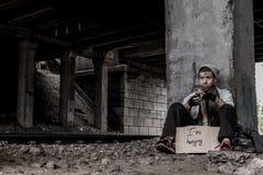 Dakloze jonge vrouw Royalty-vrije Stock Afbeelding