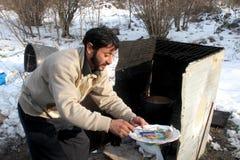 Dakloze mensen die onder de sneeuw leven Royalty-vrije Stock Fotografie