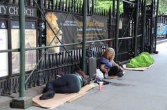 Daklozen in New York stock foto's