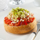 Dakos. Bread topped with chopped tomatoes and crumbled feta. Typical from Greece and Cyprus royalty free stock photography