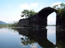 Dal Lake, Srinagar, India. Scenic view of an abandoned ancient structure from Shikara boat in Dal Lake, Srinagar, Kashmir, India, Asia Stock Image