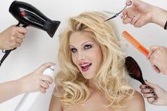 Dal parrucchiere Immagini Stock