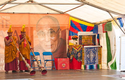 Dalai Lama's 75th birthday celebrations. Two of the Monks from the Tashi Lhunpo Monastery play the long horns as part of the opening to the 75th birthday Royalty Free Stock Photo