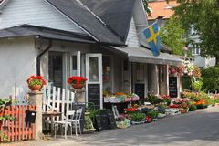 Dalaroe, Sweden - Typical shop with flowers, vegetables and fruit. DALAROE, SWEDEN - JULY 22: Typical Shop with flowers, vegetables and fruit in a small town Stock Image