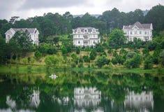 Lake scenery in Dalat, Vietnam. Dalat, Vietnam - Aug 18, 2017. Luxury villas with a lake in Dalat, Vietnam. Da Lat is a popular tourist destination located 1500m Stock Images