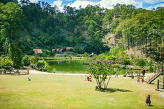 DALAT, VIETNAM - February 17, 2017: Cu Lan village at Dalat countryside, hotel and holiday resort among pine jungle, camp on grass. Field, an eco tourism in Stock Image