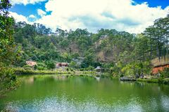 DALAT, VIETNAM - February 17, 2017: Cu Lan village at Dalat countryside, hotel and holiday resort among pine jungle, camp on grass Royalty Free Stock Image