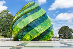DALAT, VIETNAM - MAY 6, 2018: Glass Pavilion in the form of a flower bud of the artichoke in the Lam Vien Square. With blue sky in the background Stock Photos