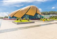 DALAT, VIETNAM - MAY 6, 2018: Glass Pavilion in the form of a flower bud of the artichoke in the Lam Vien Square. With blue sky in the background Royalty Free Stock Photos