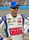 NASCAR Sprint Cup Dale Earnhardt Junior. Dale Earnhardt, Jr., hands on hips before the start of the Subway Fresh Fit 500 NASCAR Sprint Cup Race in Phoenix Royalty Free Stock Image