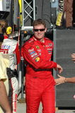 Dale earnhardt JR introduced. Earnhardt JR introduction and walking through crowd smiling in his red fire suit Royalty Free Stock Photography