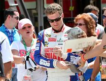 Dale Earnhardt Jr. signs autographs Royalty Free Stock Photo