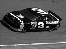 Dale Earnhardt NASCAR Driver. Dale Earnhardt racing in his famous number Three car going into turn one at Dover, Delaware Stock Images