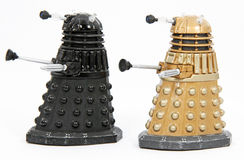Daleks. The Daleks are a race of aliens committed to dominating the universe. They appear in the popular BBC Series Dr Who Stock Images