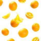 Dalende en exploderende rijpe sinaasappelen Royalty-vrije Stock Foto's