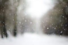Dalende sneeuw, vage Kerstmistextuur Royalty-vrije Stock Fotografie