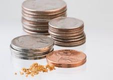 Dalende waarde van kwarten aan crumbs Royalty-vrije Stock Foto