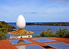 Dali egg. Egg on roof in Salvadore Dali house with view on coast in backgroud stock photo