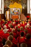 The Dali Lama is watched by monks at his teachings in Dharamsala India September 2014 Stock Image