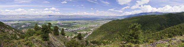 Dali Panorama. A panoramic vista of Erhai Lake and the small town of Dali in the southern province of Yunnan on a beautiful day with scattered clouds and deep Stock Photo