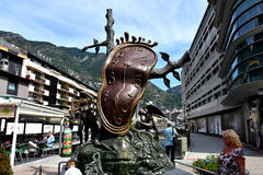 Dali sculpture in Andorra. Clock monument in Andorra la Vella made by Salvador Dali. This 5 meter sculpture of Salvador Dali is called the Generosity of time royalty free stock photos