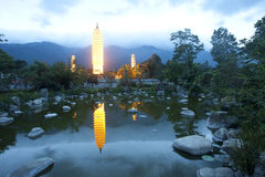 Dali three white pagodas and Cangshan Mountain in the night Stock Images