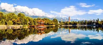 Dali three white pagodas and Cangshan Mountain. Royalty Free Stock Photos