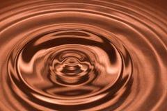 Daling van water, waterplons in Bruine kleur Stock Foto's