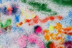 Dalingen en tekeningen gekleurde inkt op een witte achtergrond Stock Foto's