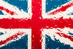 Dalingen van water op Engelse vlagachtergrond Ondiepe Diepte van Gebied Selectieve nadruk gestemd Royalty-vrije Stock Foto
