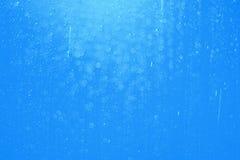 Dalingswater en bokeh abstract blauw als achtergrond Stock Afbeeldingen