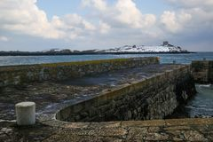 Dalkey island. Dublin. Ireland. Offshore island covered with snow with the ruins of an old church and a martello tower. Dalkey. county Dublin. Ireland Stock Image