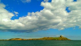 Dalkey Island, Ireland. View of uninhabited Dalkey Island from the mainland. The small island contains the ruins of a stone church, an historic Martello Tower Stock Image