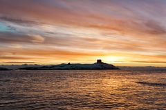 Dalky Island Snowy Winter Sunrise. Dalky Island near Dun Laoghaire in County Dublin Ireland with its Martello Tower at dawn covered in winters snow royalty free stock images