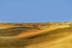 4 dalla duna 4 che colpisce sono uno sport popolare del deserto arabo Fotografie Stock Libere da Diritti