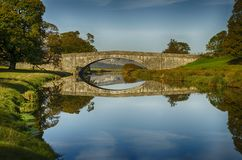 Dallam Bridge, Cumbria. Bridge in Dallam Park, Milnthorpe, Cumbria passing over the river Bela stock photos