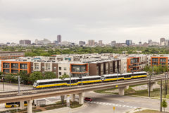 Dallas downtown view. View of Dallas downtown district with yellow passenger train in foreground. Texas, United States Stock Images