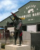Dallas Farmers Market with whimsical dog, one of six metal sculptures, Dallas, Texas. Pictured is a whimsical dog, one of six metal sculptures in front of the royalty free stock photos