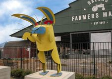 Dallas Farmers Market with whimsical rabbit, one of six metal sculptures, Dallas, Texas. Pictured is a whimsical rabbit, one of six metal sculptures in front of royalty free stock photos